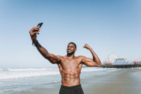 athlete-beach-biceps-1437864